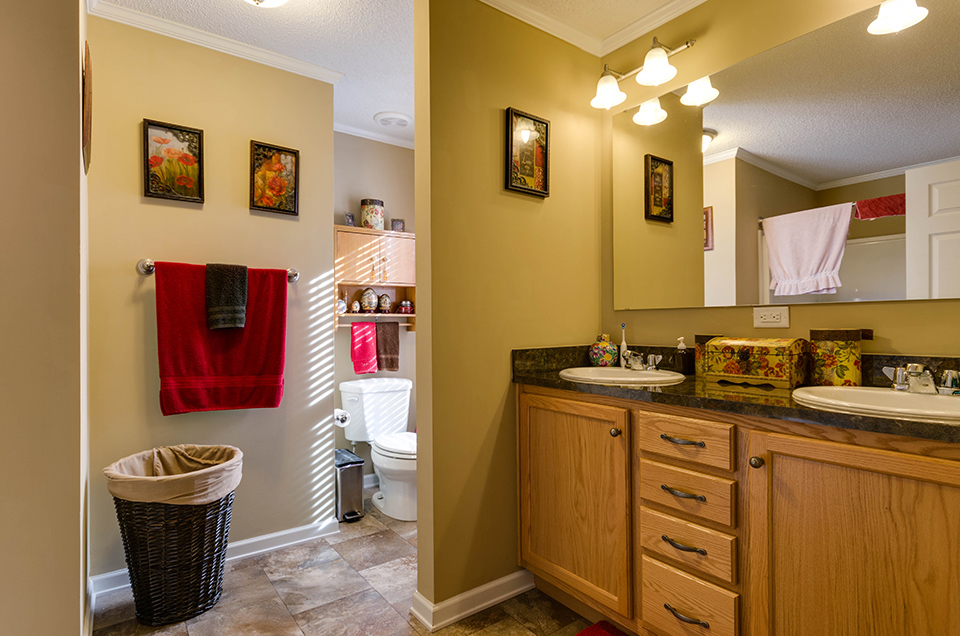 Real Estate Photography featuring a beautifully lit bathroom.