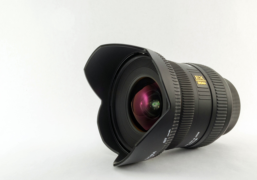 Product Style Photograph of a Sigma 10-20mm ultra wide angle lens.